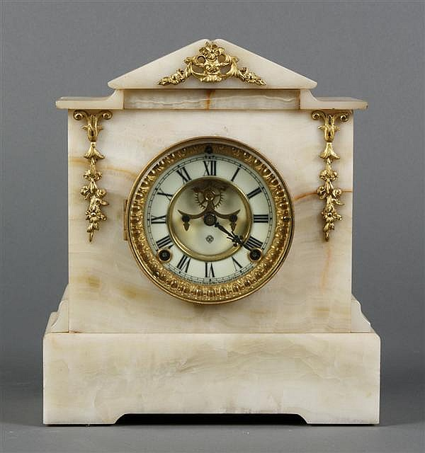 ANSONIA MARBLE ONYX MANTEL CLOCK - With open escapement, circular dial and gilt metal bezel; exterior has applied gilt metal decorat...