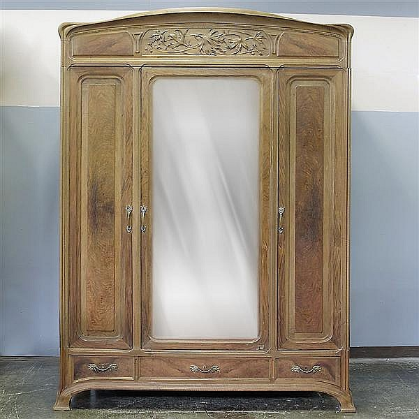 TRIPLE-DOOR ARMOIRE - Antique French walnut with arched top, figured walnut accent panels, foliate motif upper frieze, center mirror...