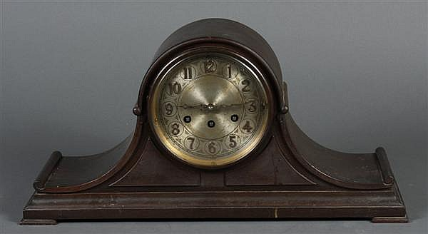WESTMINSTER MANTEL CLOCK - With ached top and mahogany case by K.C. and Co.; aluminum face; with pendulum. Marked