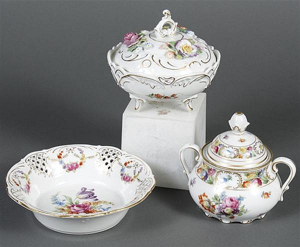 THREE PIECES OF BAVARIAN PORCELAIN - One covered sugar with handles and one wastebowl with open work; both with handpainted floral d...