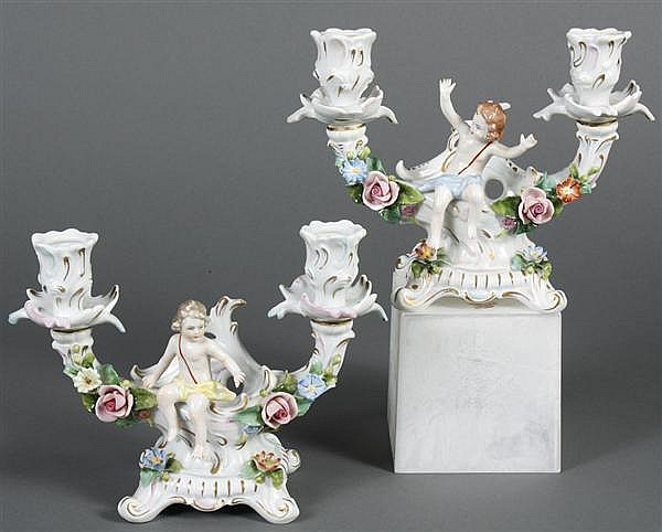 PAIR SITZENDORF PORCELAIN CANDLE HOLDERS - Two branch candle holders with a figural putto and polychrome encrusted flowers. Marked w...