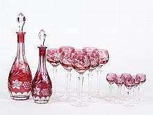 TWO CRANBERRY CUT CRYSTAL DECANTERS AND ASSORTMENT OF MATCHING STEMWARE - Cranberry cut to clear crystal decanters, eight hock glass...