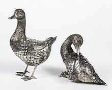 TWO STERLING SILVER BUCCELLATI TABLETOP DUCKS - Italian ducks intricately incised and layered in a natural form with what appear to...