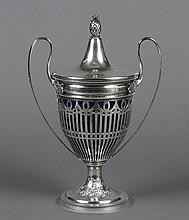 STERLING SILVER DOUBLE-HANDLE URN - Reticulated sterling silver classic urn has hollow floral-embossed base. Interior lining of coba...