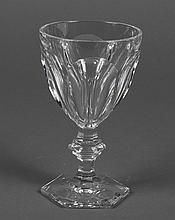 EIGHT BACCARAT CUT CRYSTAL WATER GLASSES - In the Harcourt pattern having cut panels on the bowl and a multi-sided foot. Marked Bacc...