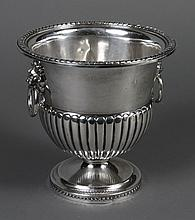 STERLING SILVER CHAMPAGNE COOLER - Urn form with double lion head handles with rings, opposing sides. Ribbed design, gadroon lip. Ma...