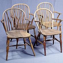 SET FOUR ARMCHAIRS - Antique American Windsor style with multiple spindle backs, carved seat platforms and turned legs with stretche...