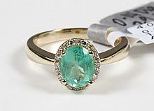 EMERALD AND DIAMOND RING - This 14 kt yellow gold lady's ring features an oval, mixed cut natural emerald (1.29 ct, bluish-green),...