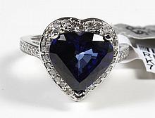 HEART-SHAPE SAPPHIRE AND DIAMOND RING - The featured gem in this 14 kt white gold ring is a 5.87 ct heart mixed cut blue sapphire. T...