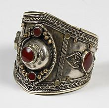 VINTAGE SILVER AND CARNELIAN CUFF BRACELET - Cuff bracelet of silver metal, no apparent maker's markings, with gold metal accents an..