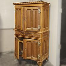 STORAGE CABINET - Antique oak with four door configuration, architectural crown molding,