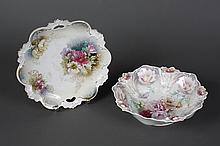 R.S.PRUSSIA PORCELAIN BOWL AND CAKE PLATE - Both decorated in a floral motif in shades of mauve and rose. Cake plate has cut-out han...