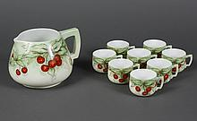 AUSTRIAN PORCELAIN CIDER PITCHER AND EIGHT MATCHING CUPS - Painted with cherries and foliage. Pitcher and cups are signed