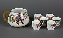 CZECHOSLOVAKIAN PORCELAIN CIDER PITCHER AND SIX CUPS - Decorated with wild rose blossoms and grapes on the vine. Marked