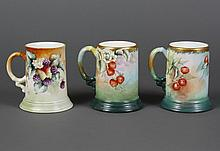 THREE J.P.L. FRENCH PORCELAIN TANKARDS - One decorated with strawberries and blossoms with enamel detail applied to the flower stame...