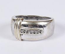 DIAMOND RING - Sterling silver band with rounded edges, seven small round diamonds bead set in a channel, where the width of the ring