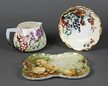 THREE CONTINENTAL PORCELAIN ITEMS - Comprising a pitcher decorated with different colored grape clusters; signed