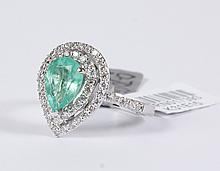PEAR CUT EMERALD & DIAMOND RING - The pear shape mixed cut 1.42 ct natural green emerald is set within a tiered diamond bezel, suppo...