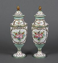 PAIR OF FRENCH PORCELAIN MANTLE VASES - Cover and foot secured by bottom bolt, brass rod, and gilt artichoke finial