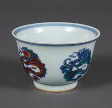 CHINESE DOUCAI PORCELAIN CUP - With dragon medallions in combinations of red, blue, green, or yellow; One in center; four outside; B...