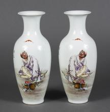 PAIR CHINESE FAMILLE ROSE PORCELAIN VASES - Baluster shape with opposing illustrations of an old man gazing upward at a fu bat