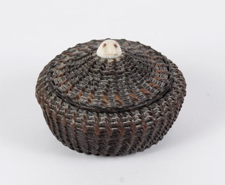 Woven Disc Basket : Small baleen basket with seal finial handle tightly woven