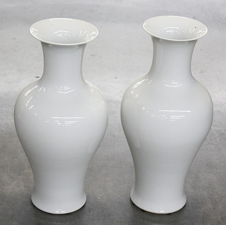 PAIR OF CHINESE PORCELAIN VASES - Pair of classical shaped Chinese white porcelain vases. Condition good. 16.5