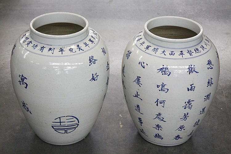 PAIR OF CHINESE CREAM AND BLUE JARS - With calligraphy decoration, dark blue on cream. Condition good. 17