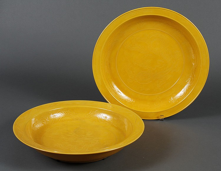 PAIR OF CHINESE LOW BOWLS - Mikado-yellow low bowls with incised dragon motif. Condition good; slight discoloration to interior of o...