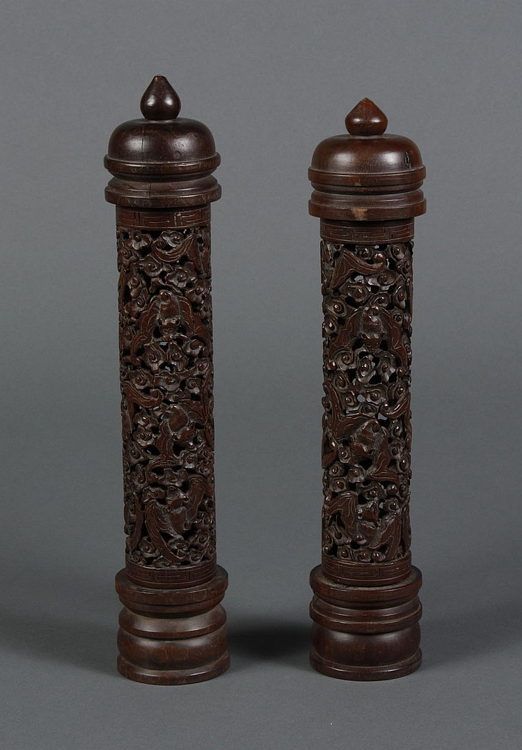 TWO CHINESE CARVED ROSEWOOD INCENSE HOLDERS - Carved rosewood with pierced design of florets and bats in various positions; detachab...