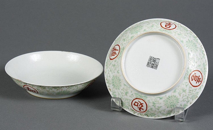 PAIR OF CHINESE PORCELAIN SAUCERS - With green enamel flowers and foliage; and with red characters on a white ground. With seal mark...