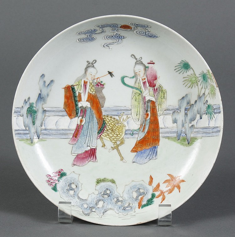 CHINESE PORCELAIN FAMILLE ROSE SAUCER DISH - Two young women stand separated by a spotted deer; one carries flowers, the other a jar...