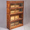 MACEY: FOUR SECTION BARRISTER'S BOOKCASE - Manufactured by Macey Company and marked with transfer label inside each section. Antique..
