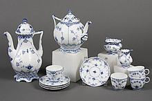 12 PIECES ROYAL COPENHAGEN PORCELAIN - Hand-painted blue and white fluted flower pattern with scalloped edges and piercing at some r...