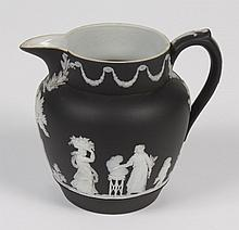 ANTIQUE WEDGWOOD BLACK DIP JASPERWARE PITCHER - Small pitcher decorated in a Greek/Roman sacrificial scene with maidens carrying off...