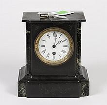 SMALL BLACK SLATE/MARBLE MANTEL CLOCK - With incised decoration and variegated marble inserts. Numbered 2328 on interior plate. Come...