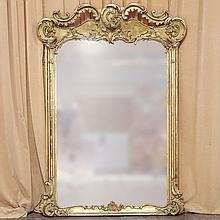 ADDENDUM: GILT WALL MIRROR - Antique Baroque style with elaborate and pierced crest rail, flat plate, straight side molding and reli...