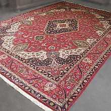 ADDENDUM; CARPET: HANDWOVEN PERSIAN KASHAN - Wool on a cotton warp with large central rhomboid medallion on a red floral and foliate...