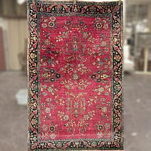 ADDENDUM: CARPET: HANDWOVEN ANTIQUE PERSIAN SAROUK - Wool on a cotton warp with multiple floral devices on a wine colored field insi...