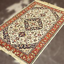 ADDENDUM; CARPET: HANDWOVEN INDO-TABRIZ - Wool on a cotton warp with rhomboid floral medallion surrounded by floral and foliate devi...