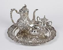 STIEFF STERLING SILVER TEA SERVICE - 4 pieces, all with spring flowers in repousse and hand chased work: footed teapot (9.75