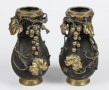 PAIR OF BRONZE KOREAN VASES - Globular shape with gilt applied grapes, vines and foliage in the amphora style