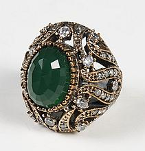OTTOMAN STYLE EMERALD RING - Central oval emerald, faceted cut, bezel set in gold-washed sterling silver and supported by shoulders...