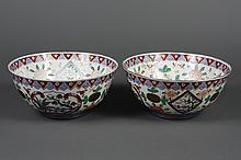 PAIR OF CHINESE PORCELAIN BOWLS - Decorated with peach trees and peonies on the exterior and interior walls and bowl floor. Characte...