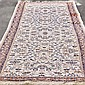 CARPET: HAND-KNOTTED KASHMIRI KASHAN RUNNER - Wool woven on a cotton warp with all-over floral and palmette design n a cream-colored...