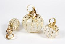 C AND H GLASSWORKS PUMPKINS AND GOURD TRIO - Comprised of two blown glass gold-tone pumpkins and one gourd; all with applied glass s...