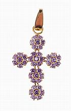 19,2 kt gold cross set with purple zirconias.