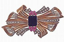 Gold and silver bow brooch set with onix, synthetic rubies & 40 rose cut diamonds.