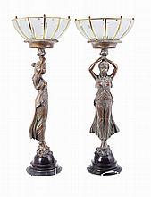 Pair of metal table lamps as ladies holding lights.