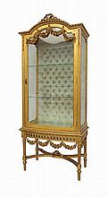 Gilt and carved wood showcase, Louis XVI style.